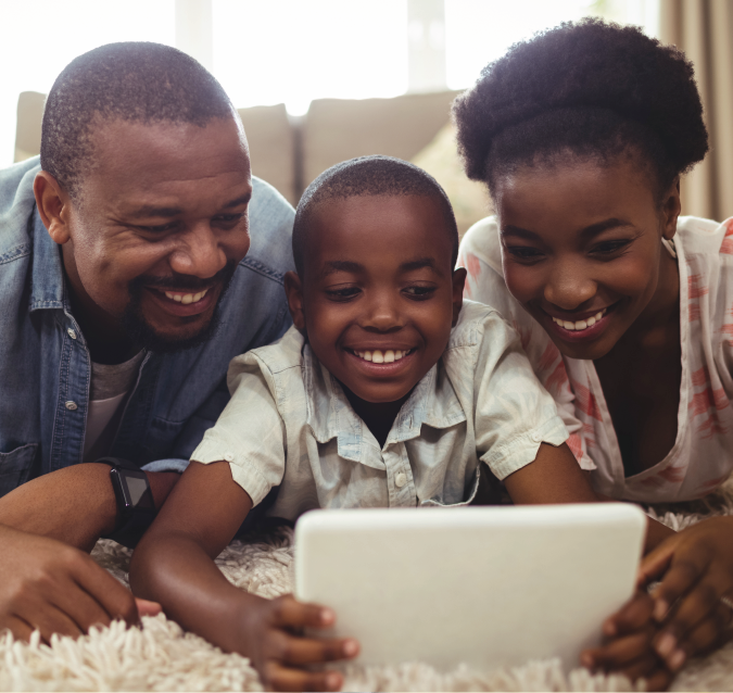 Download and Stream feature card showing a mother, father, and son looking at tablet together and smiling